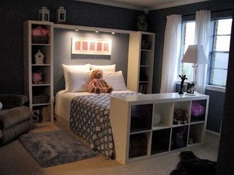 Comfortable bedroom in dark colors and shelves in the interior Kallax