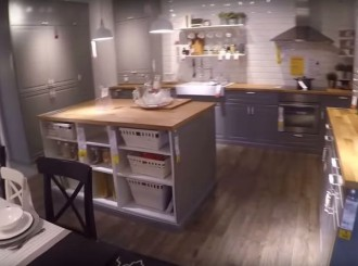 Grey IKEA kitchen with island and dining area