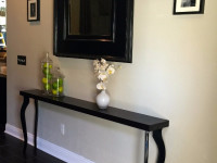 Neoclassical interior table under the wall mirror