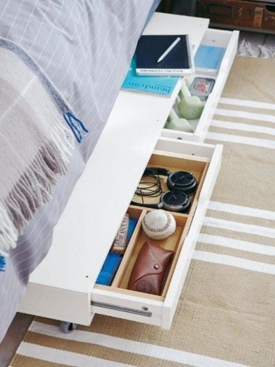 The idea for the organization of storage space under the bed