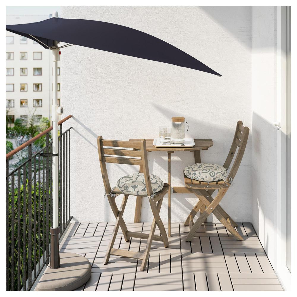 askholmen table 2 folding chairs